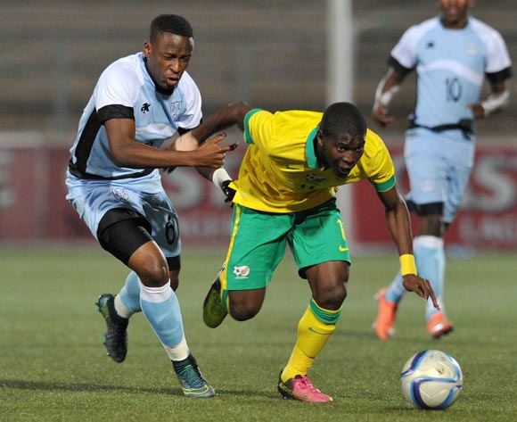 Maphosa Modiba of South Africa challenged by Thato Kebue of Botswana during the 2016 Cosafa Cup Final match between South Africa and Botswana at Sam Nujoma Stadium in Windhoek Namibia on 25 June, 2016 ©Muzi Ntombela/BackpagePix