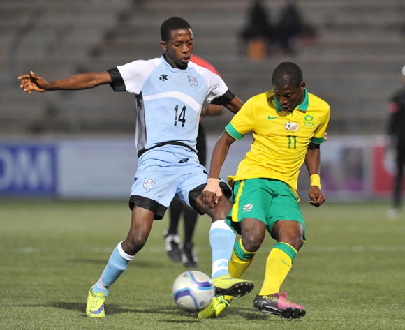 Maphosa Modiba of South Africa challenged by Thabang Sesinyi of Botswana during the 2016 Cosafa Cup Final match between South Africa and Botswana at Sam Nujoma Stadium in Windhoek Namibia on 25 June, 2016 ©Muzi Ntombela/BackpagePix