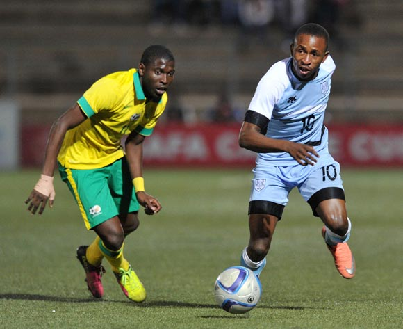 Onkabetse Makgantai of Botswana challenged by Maphosa Modiba of South Africa during the 2016 Cosafa Cup Final match between South Africa and Botswana at Sam Nujoma Stadium in Windhoek Namibia on 25 June, 2016 ©Muzi Ntombela/BackpagePix