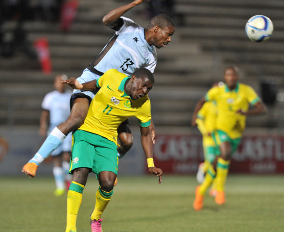 Boitumelo Mafoko of Botswana clears ball from Maphosa Modiba of South Africa during the 2016 Cosafa Cup Final match between South Africa and Botswana at Sam Nujoma Stadium in Windhoek Namibia on 25 June, 2016 ©Muzi Ntombela/BackpagePix
