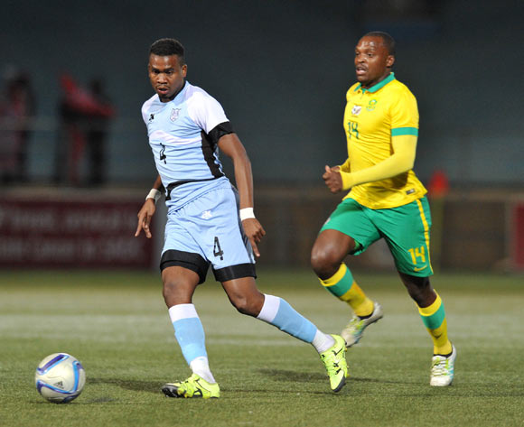 Mosha Gaolaolwe of Botswana challenged by Gift Motupa of South Africa during the 2016 Cosafa Cup Final match between South Africa and Botswana at Sam Nujoma Stadium in Windhoek Namibia on 25 June, 2016 ©Muzi Ntombela/BackpagePix