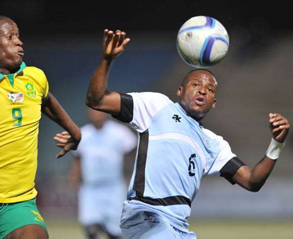 Judas Moseamedi of South Africa challenges Thato Kebue of Botswana during the 2016 Cosafa Cup Final match between South Africa and Botswana at Sam Nujoma Stadium in Windhoek Namibia on 25 June, 2016 ©Muzi Ntombela/BackpagePix