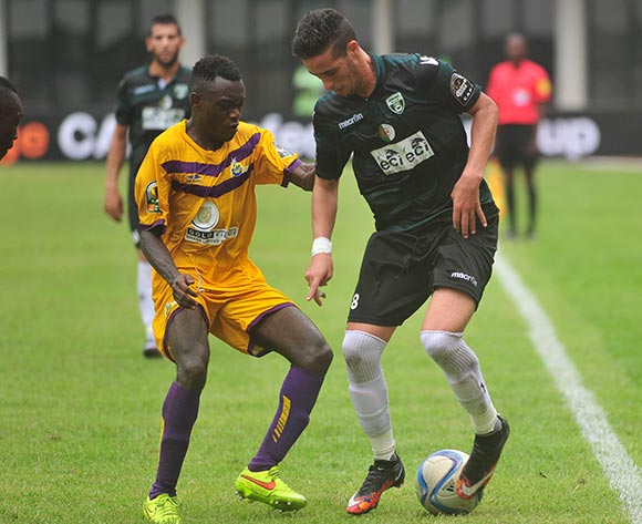 Samuel Bioh of Medeama SC challenging Sidi Salah Yaciue of Mouloudia Olympique Bejaia during the CAF Confederation Cup between Medeama SC and Mouloudia Olympique Bejaia 29 june 2016 playing in Sekondi Ghana © Christian Thompson/BackpagePix