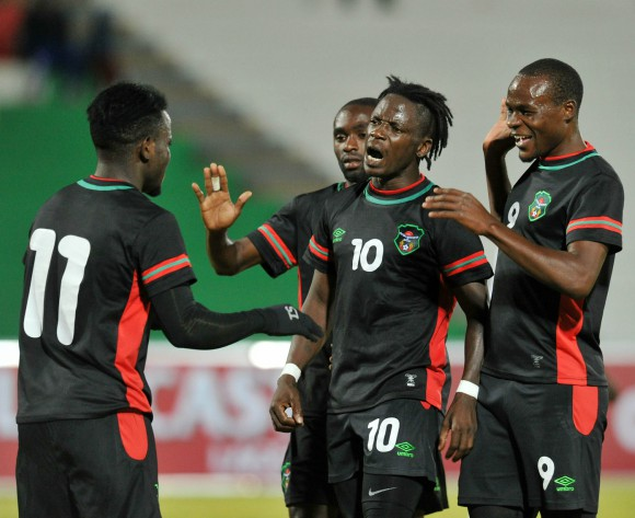 Malawi display Fair Play by using black kit against Angola