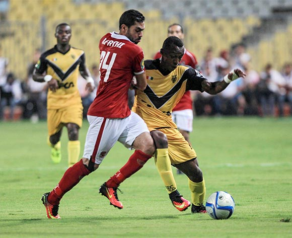 epa05396940 Al Ahly's Ahmed Fathi (L) in action against Asec Mimosas's Koffi Foda Stevens (R) during the African Champions League (CAF) group stage match between Al Ahly and Asec Mimosas at Borg Al Arab stadium in Alexandria, Egypt, 28 June 2016.  EPA/MOHAMED HOSSAM