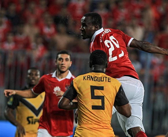 epa05396955 Al Ahly's player Joun Antoy (R) in action against Asec Mimosas's Kanguute (C) during the African Champions League (CAF) group stage match between Al Ahly and Asec Mimosas at Borg Al Arab stadium in Alexandria, Egypt, 28 June 2016.  EPA/MOHAMED HOSSAM