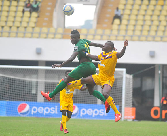 Enock Atia Agyei of Medeama SC challenging Juma Hassan Mahadhi of Young Africans SC during the CAF Confederation Cup between Medeama SC and Young Africans 26 july 2016 playing in Sekondi Ghana © Christian Thompson/BackpagePix