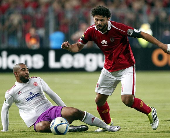 Al Ahly's player Hossam Ghaly  (R) in action against an Wydad Casablanca player Yassine El Kordy (L)