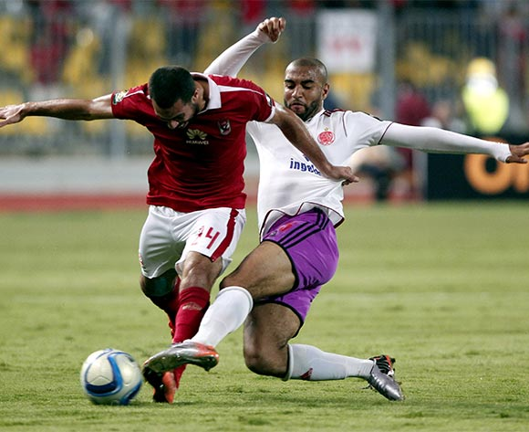 Al Ahly's player Ahmed Fathi  (L) in action against an Wydad Casablanca  player Yassine El Kordy (R) during the African Champions League (CAF) group stage match between Al Ahly and Asec Mimosas at Borg Al Arab stadium in Alexandria, Egypt, 16 July 2016.  EPA/KHALED ELFIQI