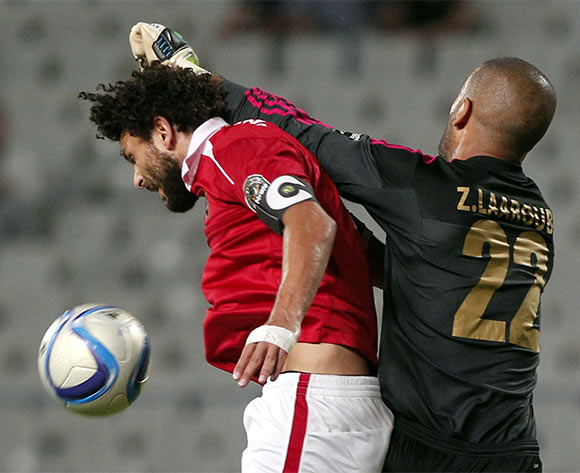 Al Ahly's player Hossam Ghaly (L) in action against an Wydad Casablanca goalkeeper Mohamed Akid during the African Champions League (CAF) group stage match between Al Ahly and Asec Mimosas at Borg Al Arab stadium in Alexandria, Egypt, 16 July 2016.  EPA/KHALED ELFIQI