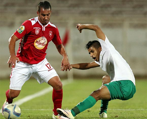 Etoile Sportive du Sahel player Merouane Tadj  (L) and Al Ahly Tripoli player  Mohamed Sola   (R) fight for the ball during the CAF Confederation Cup soccer match between Etoile Sportive du Sahel of Tunisia and Al Ahly Tripoli of Libya at the Olympique Stadium in Sousse, Tunisia, 16 July 2016.  EPA/MOHAMED MESSARA