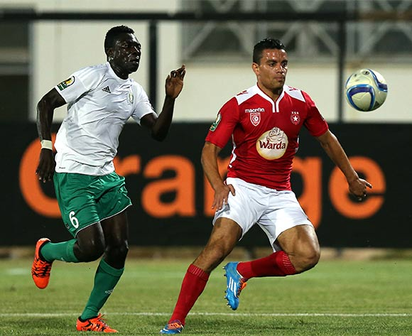 Etoile Sportive du Sahel player Ghazi Abderrazak  (R) and Al Ahly Tripoli player Ganan Youssounou  (L) fight for the ball during the CAF Confederation Cup soccer match between Etoile Sportive du Sahel of Tunisia and Al Ahly Tripoli of Libya at the Olympique Stadium in Sousse, Tunisia, 16 July 2016.  EPA/MOHAMED MESSARA
