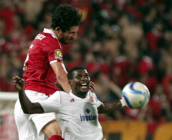 Al Ahly's player Ahmed Hegazy (L)  in action against Wydad Casablanca  player Fabrice N'Guessi (R) during the African Champions League (CAF) group stage match between Al Ahly and  Wydad Casablanca  at Borg Al Arab stadium in Alexandria, Egypt, 16 July 2016.  EPA/KHALED ELFIQI