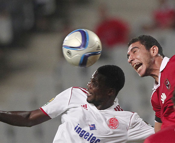 Al Ahly's player Ramy Rabia (R)  in action against Wydad Casablanca player  Fabrice N'Guessi (L) during the African Champions League (CAF) group stage match between Al Ahly and  Wydad Casablanca  at Borg Al Arab stadium in Alexandria, Egypt, 16 July 2016.  EPA/KHALED ELFIQI