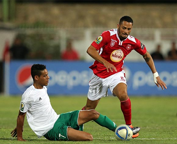 Etoile Sportive du Sahel player Diego Acosta (R) and Al Ahly Tripoli player Mohamed Sola (L) fight for the ball during the CAF Confederation Cup soccer match between Etoile Sportive du Sahel of Tunisia and Al Ahly Tripoli of Libya at the Olympique Stadium in Sousse, Tunisia, 16 July 2016.  EPA/MOHAMED MESSARA