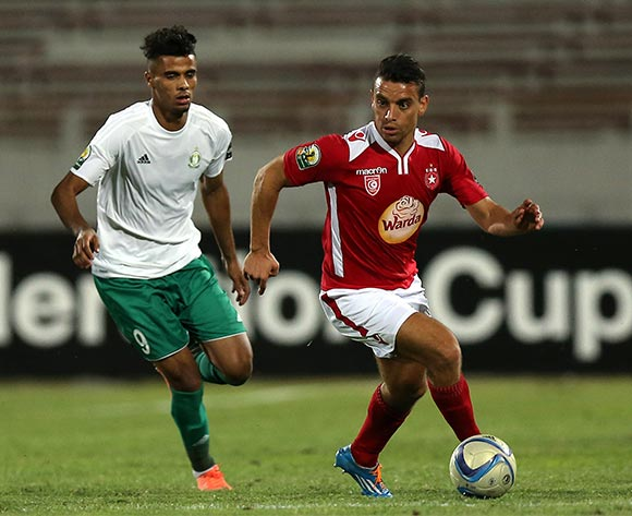 Etoile Sportive du Sahel player Ghazi Abderrazak (L) and Al Ahly Tripoli player Hamza Elbordji (R) fight for the ball during the CAF Confederation Cup soccer match between Etoile Sportive du Sahel of Tunisia and Al Ahly Tripoli of Libya at the Olympique Stadium in Sousse, Tunisia, 16 July 2016.  EPA/MOHAMED MESSARA