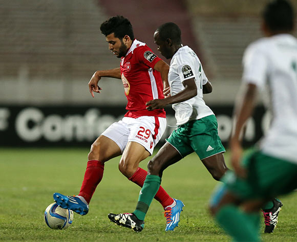 Etoile Sportive du Sahel player Mohamed Amine Ben Amor (L) and Al Ahly Tripoli player Morice Arcoma (R) fight for the ball during the CAF Confederation Cup soccer match between Etoile Sportive du Sahel of Tunisia and Al Ahly Tripoli of Libya at the Olympique Stadium in Sousse, Tunisia, 16 July 2016.  EPA/MOHAMED MESSARA