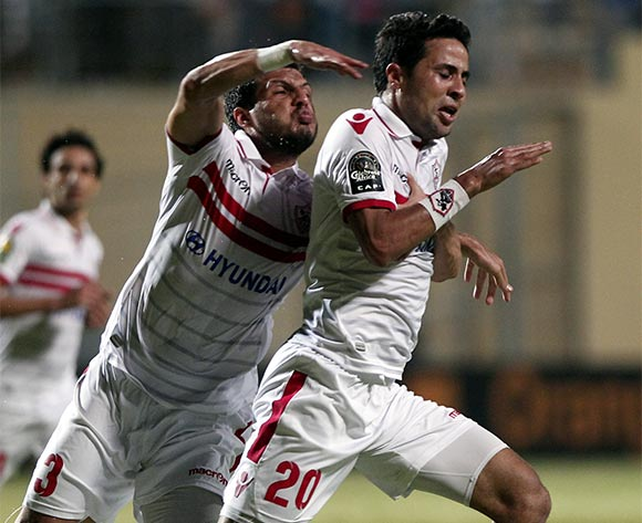 epa05429812 Zamalek's player Mohamed Ibrahim (R) celebrates after scoring against Sundowns during the African Champions League (CAF) group stage soccer match between Zamalek's and Sundowns at Petro Sport stadium in Cairo, Egypt, 17 July 2016  EPA/KHALED ELFIQI