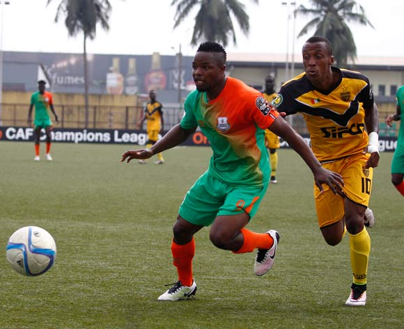 epa05443885 Mimosa's Krahire Yannick Zakri (R) vies for the ball with Zesco's Lazarous Kambole (L) during their CAF Champions League group stage match between Asec Mimosa vs Zesco's at Stade Robert Champroux in Abidjan, Ivory Coast, 27 July 2016.  EPA/LEGNAN KOULA