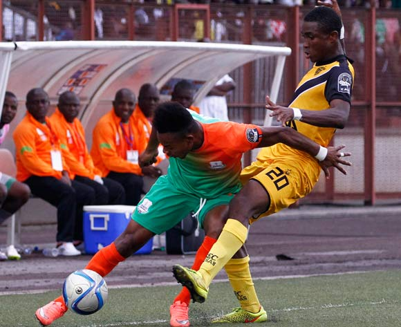 epa05444024 Mimosa's Koffi Constant KouamÈ (R) vies for the ball with Zesco's Idris Mbombo (R) during their CAF Champions League group stage match between Asec Mimosa vs Zesco's at Stade Robert Champroux in Abidjan, Ivory Coast, 27 July 2016.  EPA/LEGNAN KOULA