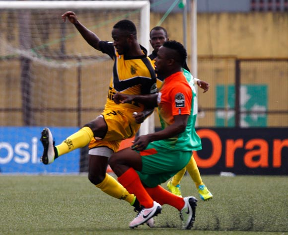 epa05444021 Mimosa's Coulibaly Dala (L) vies for the ball with Zesco's Simon Silwimba ( R) during their CAF Champions League group stage match between Asec Mimosa vs Zesco's at Stade Robert Champroux in Abidjan, Ivory Coast, 27 July 2016.  EPA/LEGNAN KOULA