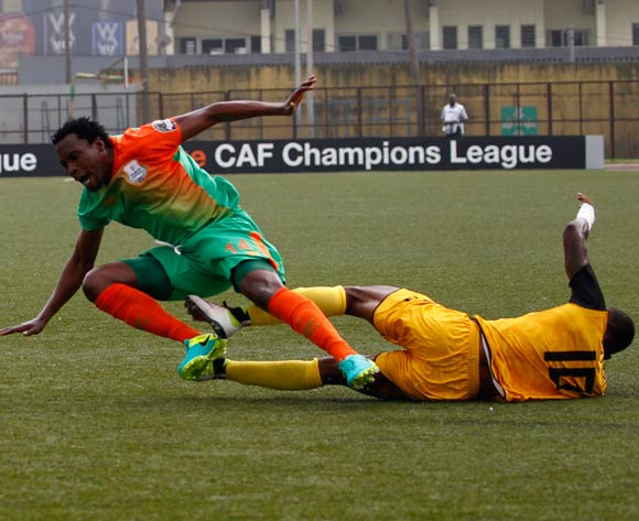 epa05444023 Mimosa's Krahire Yannick Zakri (R) vies for the ball with Zesco's Jackson Wannza (L) during their CAF Champions League group stage match between Asec Mimosa vs Zesco's at Stade Robert Champroux in Abidjan, Ivory Coast, 27 July 2016.  EPA/LEGNAN KOULA