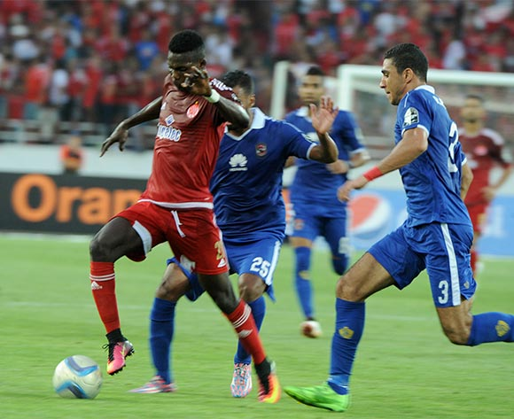 epa05444311 Al-Ahly's Ramy Hisham (R) and Housam Ashour (C) vies for the ball  with Wydad's Fabrice Ondama (L) during their CAF Champions League group A stage soccer match between Egypt's Al-Ahly and Morocco's Wydad Casablanca at Prince Moulay Abdellah Stadium in Rabat, Morocco, on 27 July 2016. Al-Ahly won 1-0.  EPA/ABDELHAK SENNA