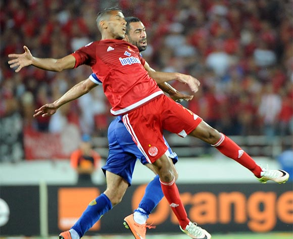 epa05444319 Al-Ahly's Ahmed Fathi (Blue) vies for the ball  with Wydad's Brahim nakach (Red) during their CAF Champions League group A stage football match between Egypt's Al-Ahly and Morocco's Wydad Casablanca at Prince Moulay Abdellah Stadium in Rabat, Morocco, on 27 July 2016. Al-Ahly won 1-0.  EPA/ABDELHAK SENNA