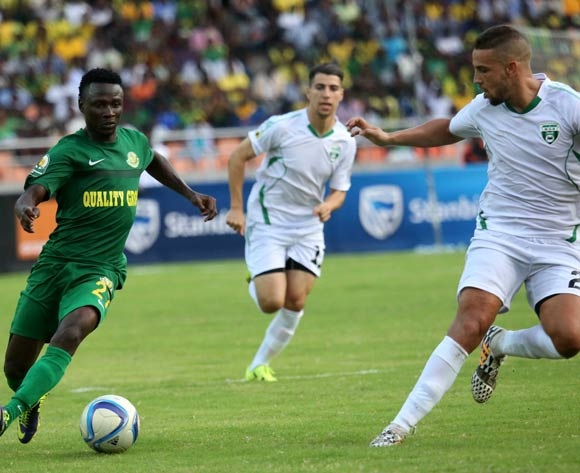 Amar Benmelouka (R), of Algeria's Mo Bejaia, challenges Simon Msuva of Tanzania's Young Africa's FC during the 13th edition of CAF confederation Cup match at the National Stadium in Dar es Salaam, Tanzania, Suturday August 13, 2016. Young Africans FC won by 1-0. (Photo; KHALFAN SAID)