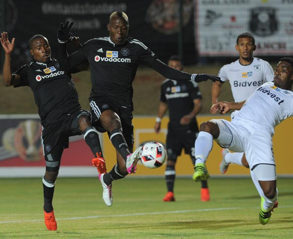 Thulani Hlatshwayo of Bidvest Wits tackles Tendai Ndoro of Orlando Pirates (m) and Thabo Matlaba of Orlando Pirates during the MTN8 match between Buidvest Wits and Orlando Pirates   27 August 2016 at Bidvest Stadium Pic Sydney Mahlangu/ BackpagePix