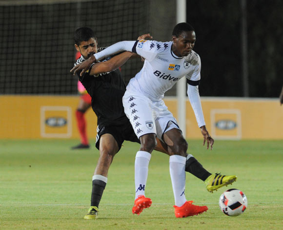 Mogakolodi Ngele of Bidvest Wits is challenged by Abbubaker Mobara of Orlando Pirates  during the MTN8 match between Buidvest Wits and Orlando Pirates 27 August 2016 at Bidvest Stadium Pic Sydney Mahlangu/ BackpagePix