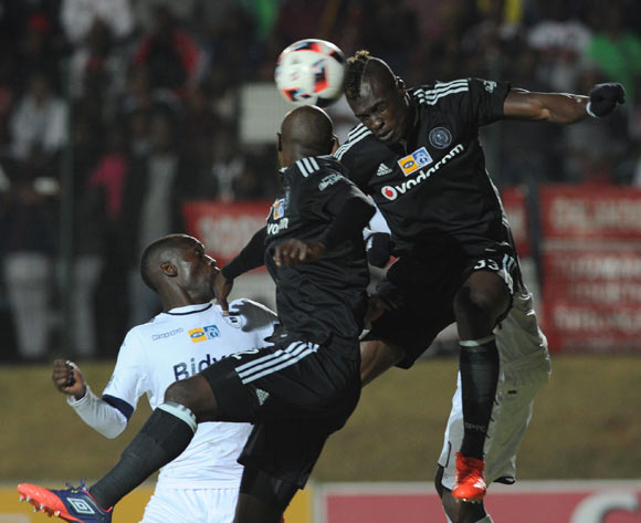 Cut berth Malajila of Bidvest Wits is challenged by Edwin Gyimah of Orlando Pirates  during the MTN8 match between Buidvest Wits and Orlando Pirates 27 August 2016 at Bidvest Stadium Pic Sydney Mahlangu/ BackpagePix