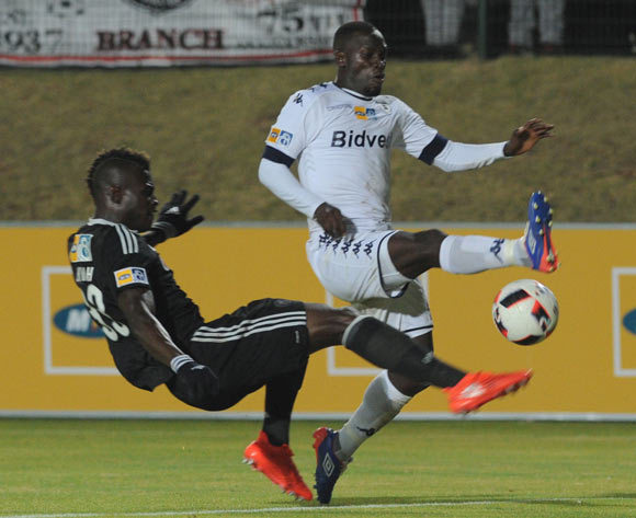 Cuthbert Malajila of Bidvest Wits is challenged by Edwin Gyimah of Orlando Pirates  during the MTN8 match between Buidvest Wits and Orlando Pirates 27 August 2016 at Bidvest Stadium Pic Sydney Mahlangu/ BackpagePix