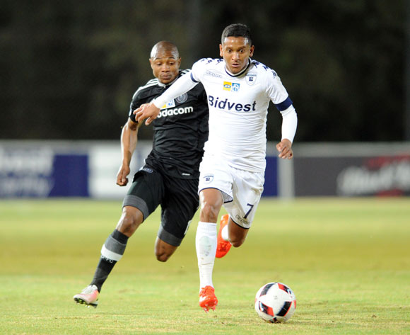 Thabo Qalinge of Orlando Pirates challenges Daine Klate of Bidvest Wits  during the MTN8 match between Buidvest Wits and Orlando Pirates 27 August 2016 at Bidvest Stadium Pic Sydney Mahlangu/ BackpagePix