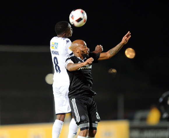 Oupa Manyisa of Orlando Pirates is challenged by Thabang Monare of Bidvest Wits during the MTN8 match between Buidvest Wits and Orlando Pirates 27 August 2016 at Bidvest Stadium Pic Sydney Mahlangu/ BackpagePix
