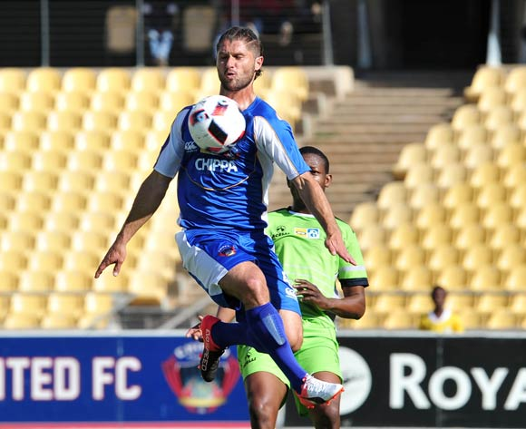 Marc Van Heerden of Chippa United challenged by Ndumiso Mabena of Platinum Stars during the MTN8 Quarter Final football match between Platinum Stars and Chippa United at the Royal Bafokeng Stadium in Rustenburg, South Africa on August 27, 2016 ©Samuel Shivambu/BackpagePix