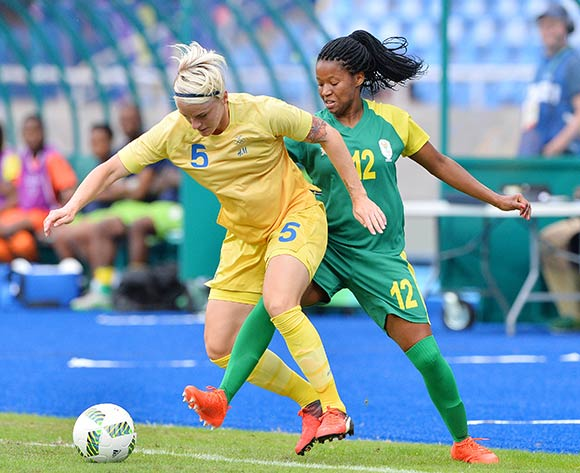 Jermaine Seoposenwe of South Africa (r) tackles Nilla Fischer of Sweden during the 2016 Rio Olympic  Games Women Football match between South Africa and Sweden at the Olympic Stadium in Rio de Janeiro, Brazil on 03 August 2016 ©Gavin Barker/BackpagePix
