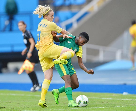 Nothando Vilakazi of South Africa (r) tackled by Lisa Dahlkvist of Sweden during the 2016 Rio Olympic  Games Women Football match between South Africa and Sweden at the Olympic Stadium in Rio de Janeiro, Brazil on 03 August 2016 ©Gavin Barker/BackpagePix