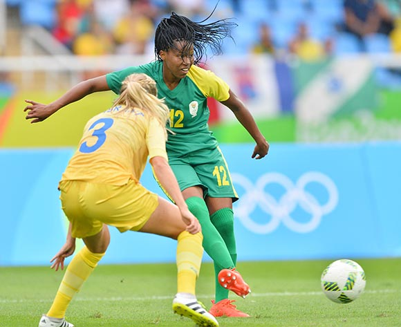 Jermaine Seoposenwe of South Africa (r) plays ball away from Linda Sembrant of Sweden during the 2016 Rio Olympic  Games Women Football match between South Africa and Sweden at the Olympic Stadium in Rio de Janeiro, Brazil on 03 August 2016 ©Gavin Barker/BackpagePix