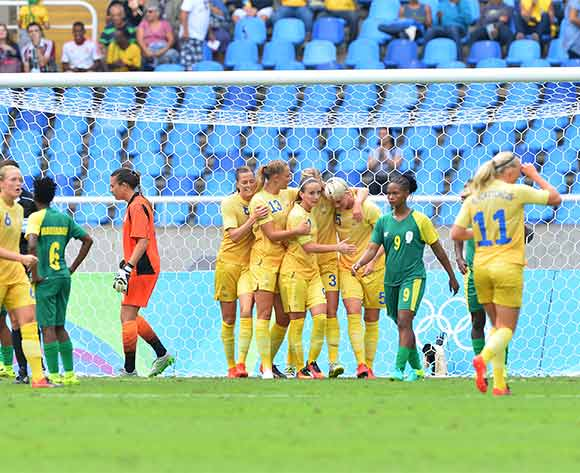 Nilla Fischer of Sweden (number 5) celebrates goal as South African players react in disappointment during the 2016 Rio Olympic  Games Women Football match between South Africa and Sweden at the Olympic Stadium in Rio de Janeiro, Brazil on 03 August 2016 ©Gavin Barker/BackpagePix