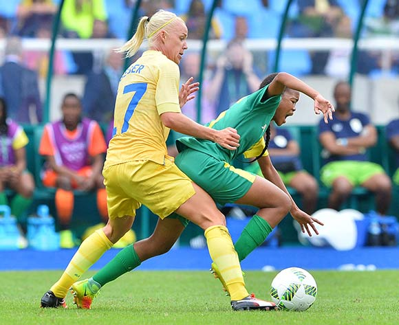 Linda Motlhalo of South Africa fouled by Caroline Seger of Sweden during the 2016 Rio Olympic  Games Women Football match between South Africa and Sweden at the Olympic Stadium in Rio de Janeiro, Brazil on 03 August 2016 ©Gavin Barker/BackpagePix