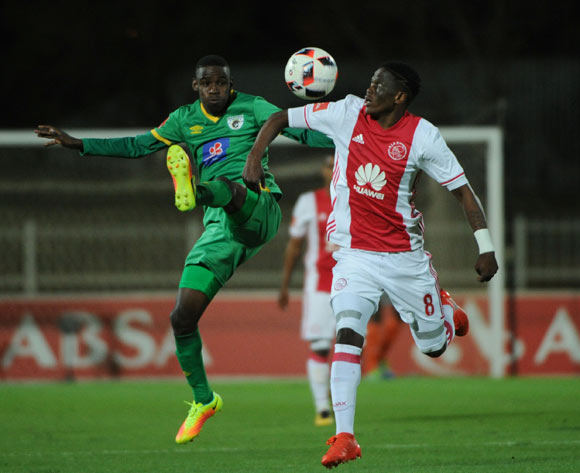 Collins Makgaka of Baroka FC is challenged by Ndiviwe Mdabuka of Ajax Cape Town during the Absa Premiership match between Baroka FC and Ajax Cape Town  23 August 2016 at Old Peter Mokaba Stadium Pic Sydney Mahlangu/ BackpagePix