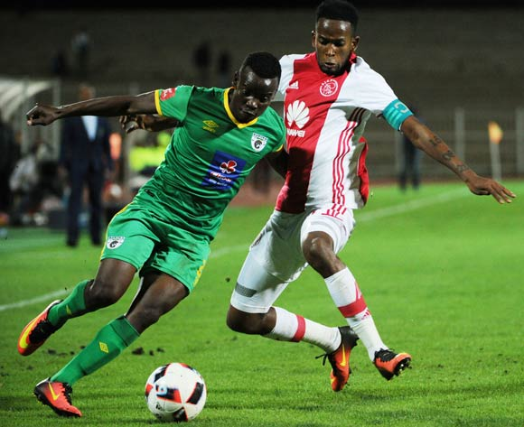 Mosa Lebusa of Ajax Cape Town is challenged by Sipho Moeti of Baroka FC during the Absa Premiership match between Baroka FC and Ajax Cape Town  23 August 2016 at Old Peter Mokaba Stadium Pic Sydney Mahlangu/ BackpagePix