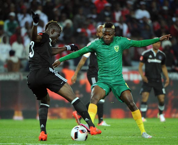 Edwin Gyimah of Orlando Pirates is challenged by Kudakwashe Mahachi of Golden Arrows  during the Absa Premiership match between Orlando Pirates and Golden Arrows  23 August 2016 at Orlando Stadium Pic Sydney Mahlangu/ BackpagePix