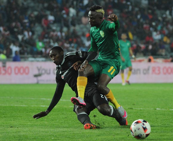 Ayanda Gcaba of Orlando Pirates tackles Kudakwashe Mahachi of Golden Arrows during the Absa Premiership match between Orlando Pirates and Golden Arrows  23 August 2016 at Orlando Stadium Pic Sydney Mahlangu/ BackpagePix