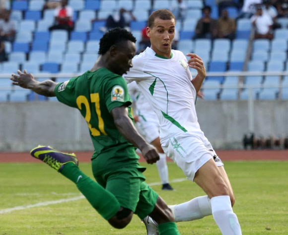 Simon Msuva (L), of Tanzamia's Young Africans FC, battle for the ball against Sofiane Baouali of Algeria's Mo Bejaia FC , during the 13th edition of CAF confederation Cup match at the National Stadium in Dar es Salaam, Tanzania, Suturday August 13, 2016. Young Africans FC won by 1-0. (Photo; KHALFAN SAID)