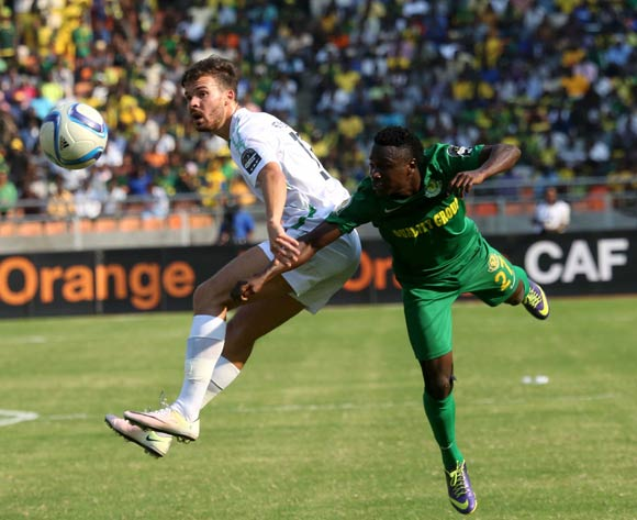 Young African' Simon Msuva (R), and Mo Bejaia's Ismael Benetayib, fly high as they fight for the ball during the 13th edition of CAF confederation Cup match at the National Stadium in Dar es Salaam, Tanzania, Suturday August 13, 2016. (Photo; KHALFAN SAID