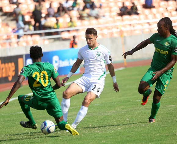 Sofiane Khadir of Mo Bjaia FC from Algeria dribbles past Tanzania's Young Africans FC players, during the 13th edition of CAF confederation Cup match at the National Stadium in Dar es Salaam, Tanzania, Suturday August 13, 2016. (Photo; KHALFAN SAID)