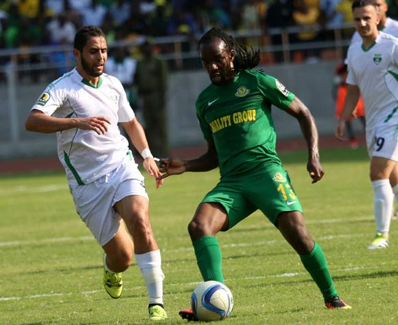 Thaban Kamusoko (C), of Young Africans FC, dribbles as he under pressure from Mo Bejaia players, during the 13th edition of CAF confederation Cup match at the National Stadium in Dar es Salaam, Tanzania, Suturday August 13, 2016. Young Africans FC won by 1-0. (Photo; KHALFAN SAID)