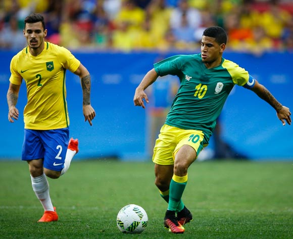 Keagan Dolly (R) of South Africa in action against Zeca (L) of Brazil during the men's first round match between Brazil and South Africa for the Rio 2016 Olympic Games Soccer tournament at Mane Garrincha stadium in Brasilia, Brazil, 04 August 2016.  EPA/FERNANDO BIZERRA JR.